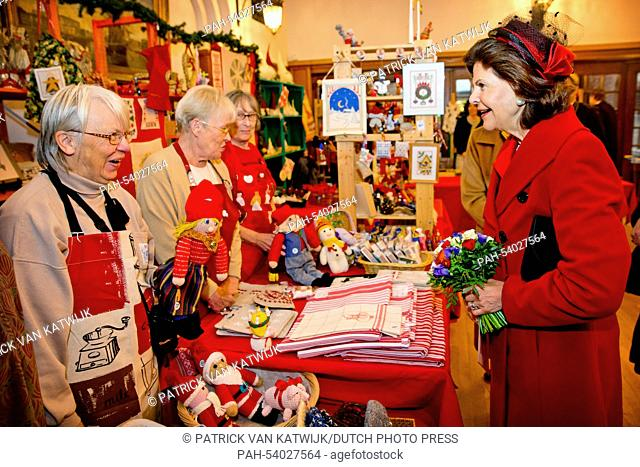 Queen Silvia of Sweden visits the christmas market in the Swedish Church in Paris, France, 2 December 2014. The King and Queen are in France for a three day...