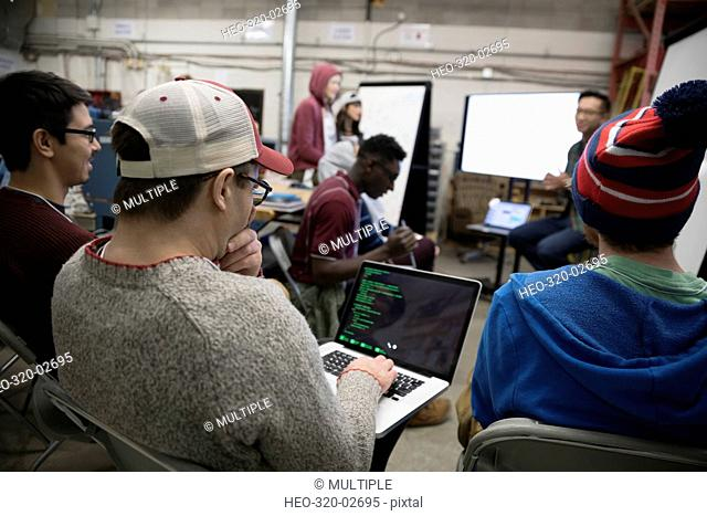 Hackers with laptop pitching ideas at hackathon