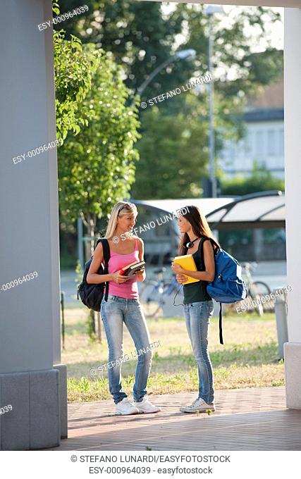 Happy students walking