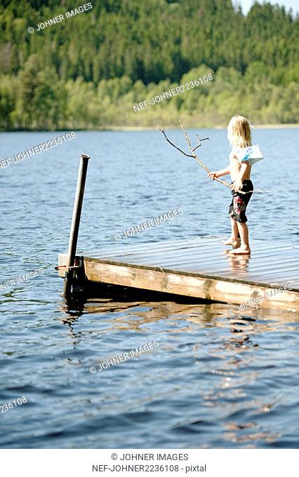 Boy standing on jetty
