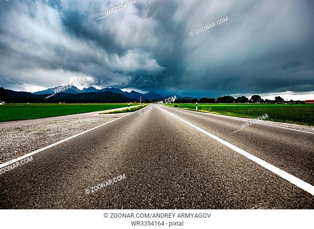 Road leading into a storm - Forggensee and Schwangau, Germany Bavaria