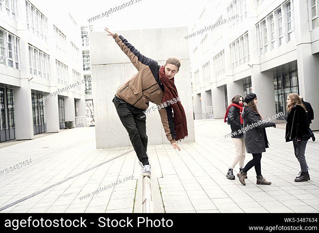 young man balancing