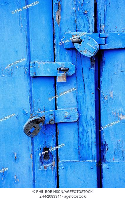 Maidstone, Kent , England. Three padlocks on a painted blue door
