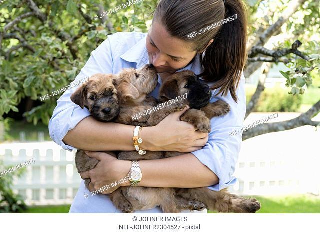Woman holdinig puppies