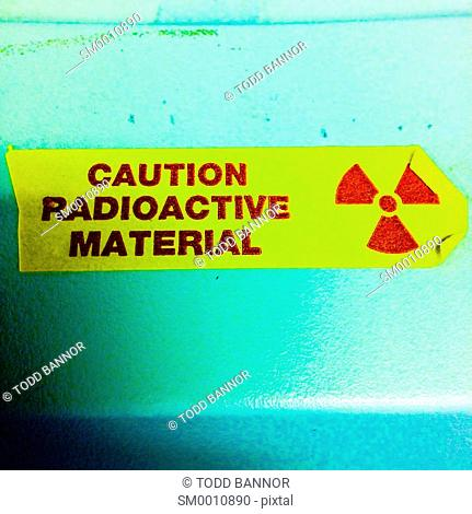 Caution radioactive material tape on lab instrument