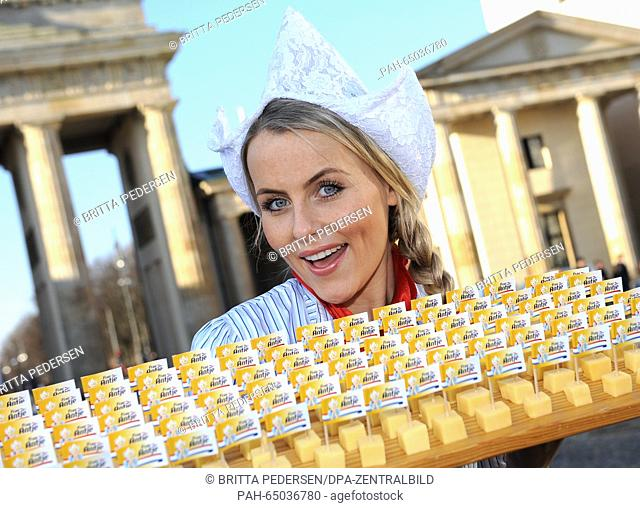 Dutch cheese queen Floor Schothorst poses as Dutch advertising character 'Frau Antje' (Mrs. Antje) holding a tablet with Dutch cheese and wearing a...