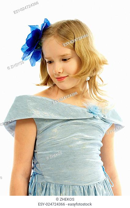 Young Girl in Princess Dress Blue Bow in her Hair isolated on white background