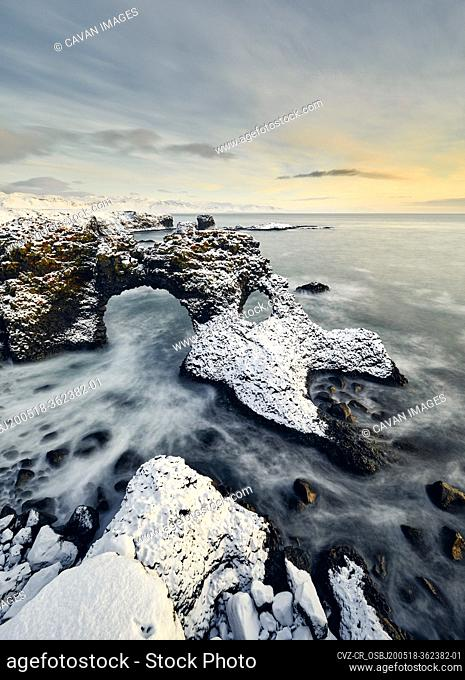 Wonderful seascape of rocky seashore during sunset in winter