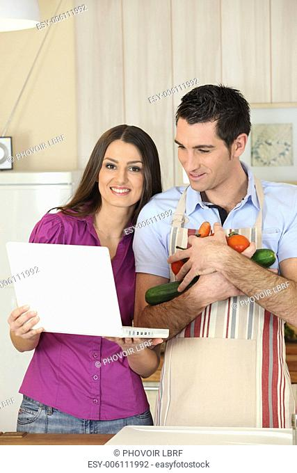 Couple looking-up recipe