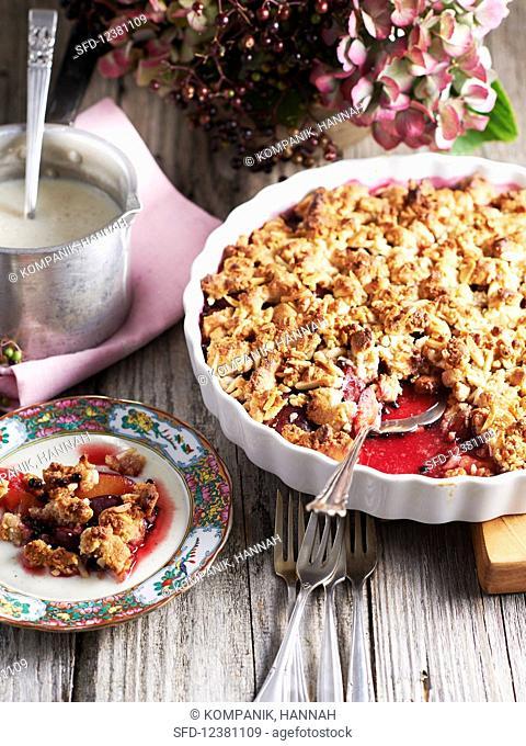 Marzipan crumble with prunes and elderberries