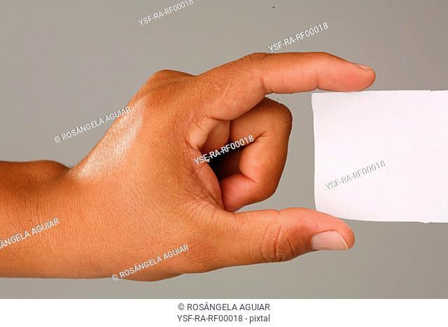 Hand male holding paper, Belém, Pará, Brazil