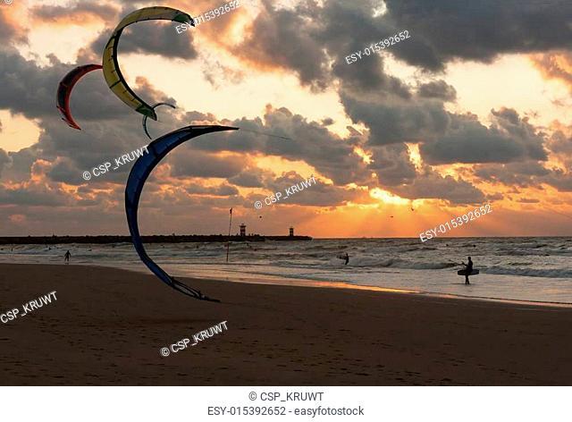 Kite surfing in the sunset at the beach of Scheveningen, the Netherlands