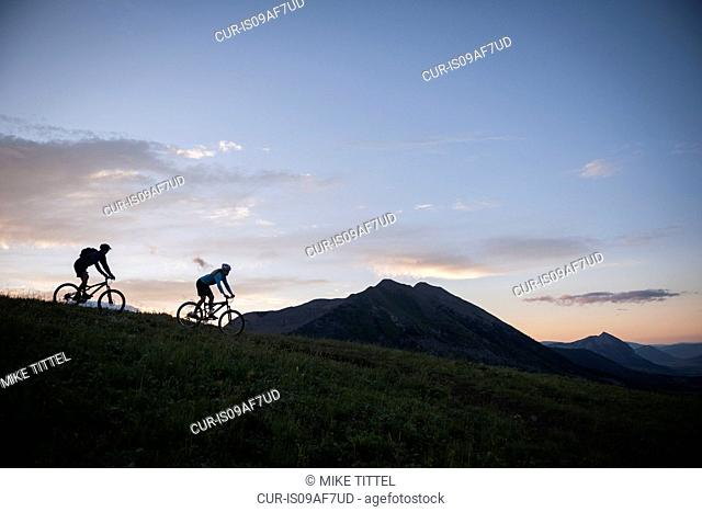 Two people on bike trail 403, West Elk Mountains, Crested Butte, Colorado, USA