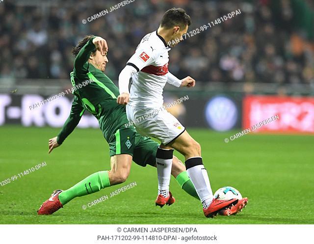 Bremen's Thomas Delaney (r) and Stuttgart's Josip Brekalo vie for the ball during the German Bundesliga football match between Werder Bremen and VfB Stuttgart...