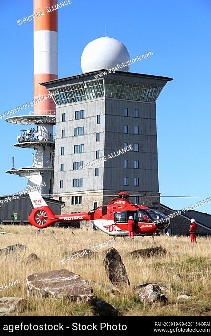 """19 September 2020, Saxony-Anhalt, Schierke: A rescue helicopter of the """"""""DRF Luftrettung"""""""" has landed on the """"""""Brocken"""""""" in the Harz Mountains"""