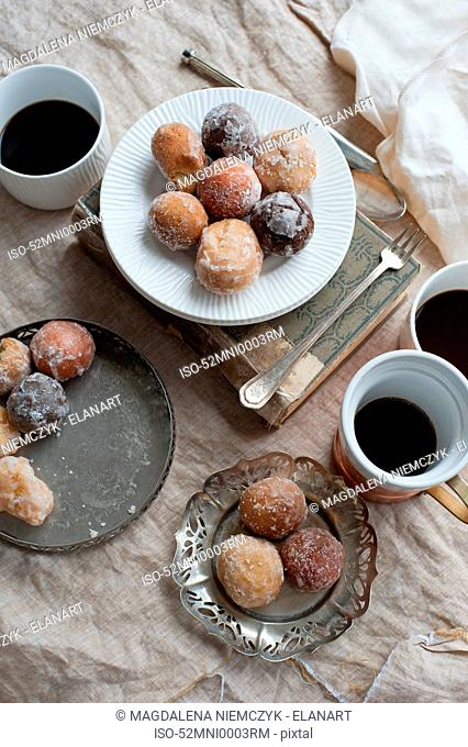 Plate of desserts with coffee