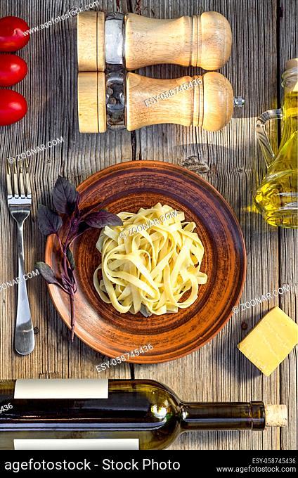 Fettuccine and wine. Vegetarian dinner in the restaurant. basil
