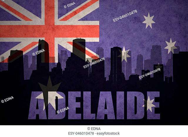 abstract silhouette of the city with text Adelaide at the vintage australian flag background