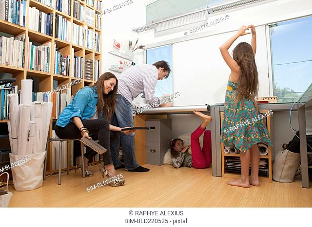Family playing in home office