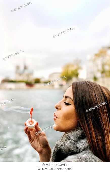 Paris, France, woman blowing soap bubbles
