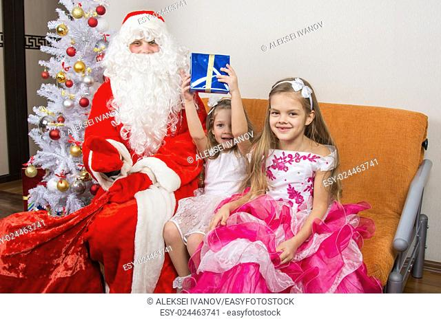 Santa Claus presented the first gift girls