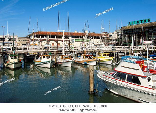 Fishing boats docked at the Fisherman's Wharf at the waterfront of San Francisco, California, USA