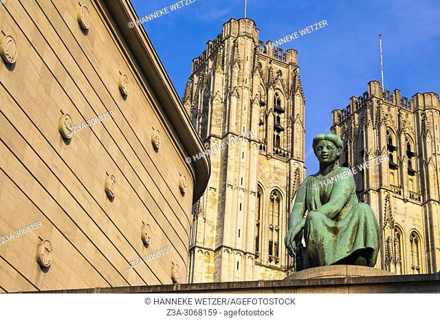 Statue in front of the national bank and the cathedral of Brussels, Belgium, Europe