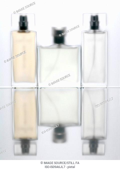 Blurred view of perfume bottles