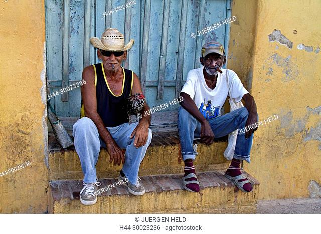 Old Men with cigars sitting on stairs near Plaza Mayor, Trinidad Cuba