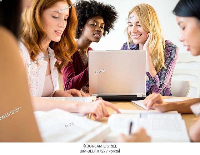 Businesswomen working together in meeting