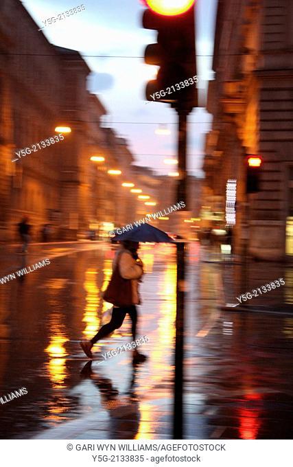 rain on corso vittorio emanuele street in rome, italy