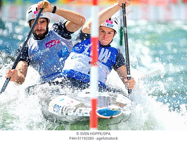 Gauthier Klauss and Matthieu Peche of France paddle down the ice canal during the canoe double C2 at the men's Canoe slalom World Cup final in Augsburg, Germany