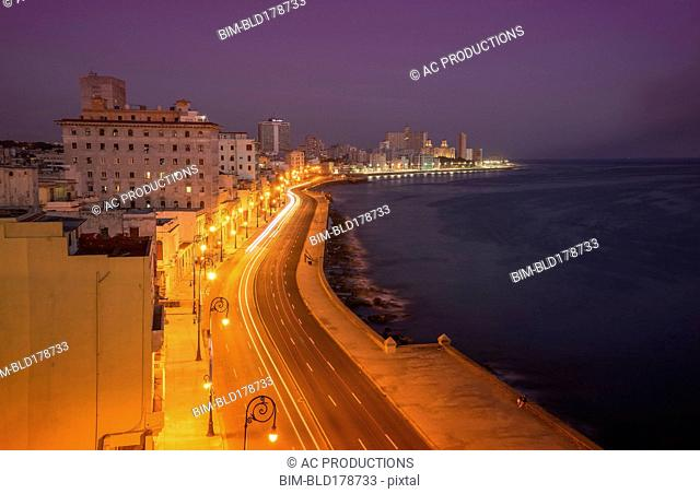 Long exposure of cars on waterfront at night, Havana, Cuba