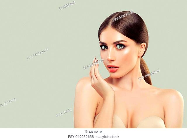 Cute Surprisrd Woman Fashion Model with Clear Skin, Brown Hair and Opened Mouth. Surprised Girl on White Background. Presenting your product