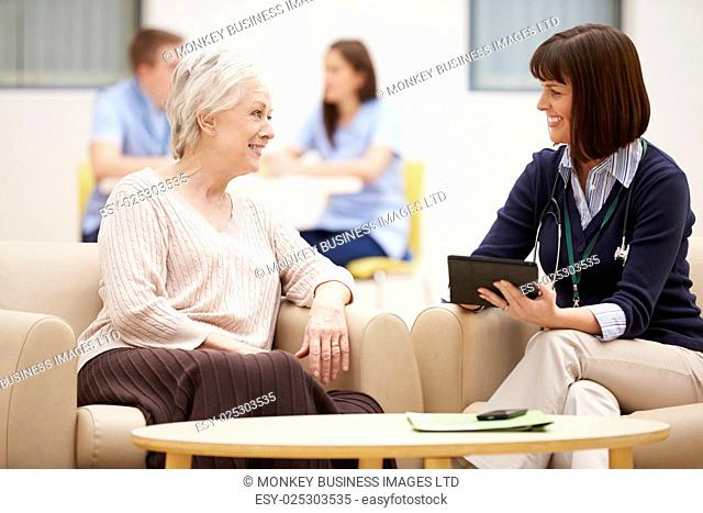Senior Woman Discussing Test Results With Doctor
