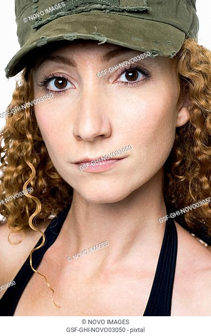 Portrait of Curly Red Haired Woman with Camouflage Hat