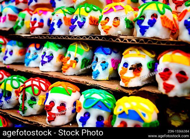Mexican sugar skull candy with a bee, calaveras, traditionally used for dias de los muertos, halloween at the market of Merida, Mexico