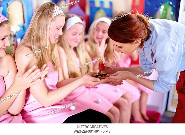 Girls on a beauty farm receiving beauty treatment