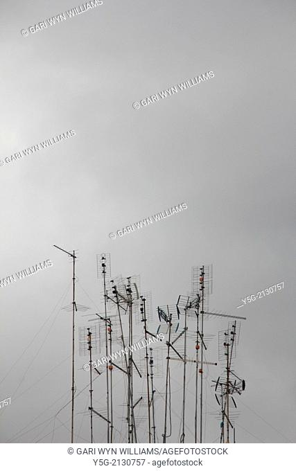 many tv aerials on roof top