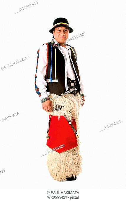 Happy Latino man from South America highland dressed in Folklore clothes with Llama fur from Ecuador, Peru or Bolivia, isolated