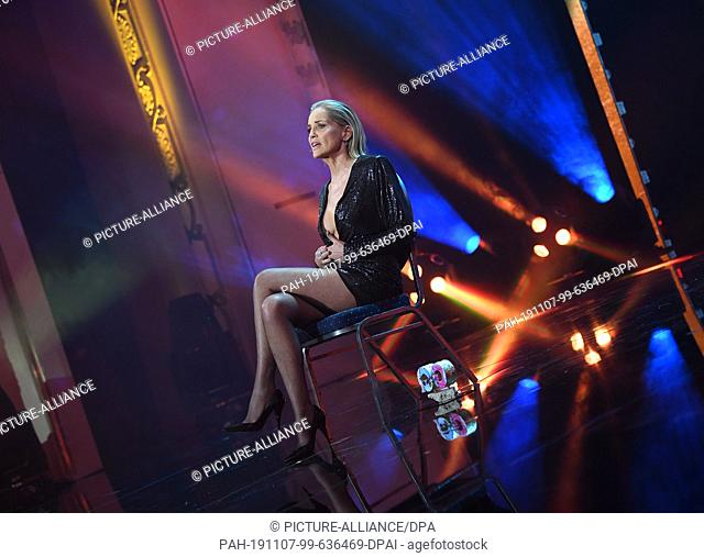 07 November 2019, Berlin: Sharon Stone, an actress from the USA, sits on stage after winning the Woman of the Year award at the 2019 GQ Men of the Year Awards