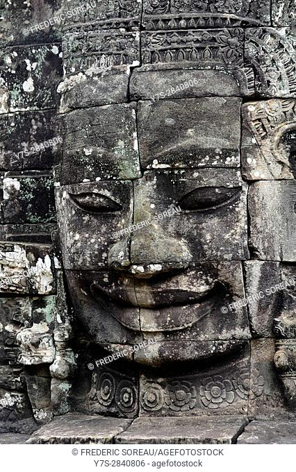 Carved stone head at Bayon temple, Angkor Wat, Cambodia, Indochina, Southeast Asia, Asia