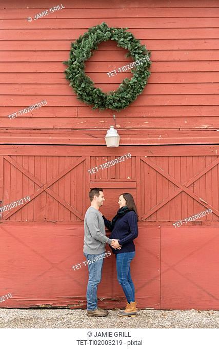 Couple below wreath