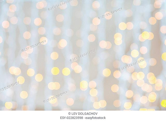 holidays, party and celebration concept - blurred glden lights background