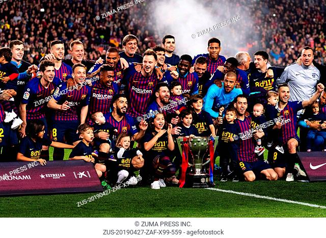 BARCELONA, April 28, 2019 Barcelona's players celebrate with the trophy after a Spanish league soccer match between FC Barcelona and Levante in Barcelona, Spain