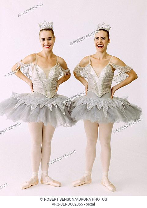 Two ballet dancers standing side by side