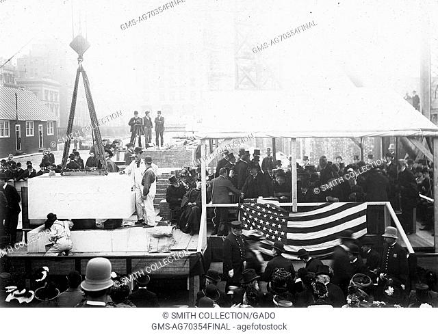 Black and white photograph showing a large group of people, including photographers and officers, at the cornerstone laying ceremony, United States, 1902