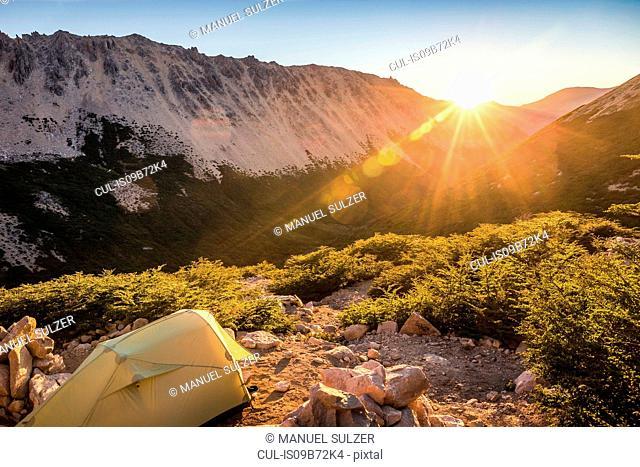 Tent in mountain landscape at sunset, Nahuel Huapi National Park, Rio Negro, Argentina