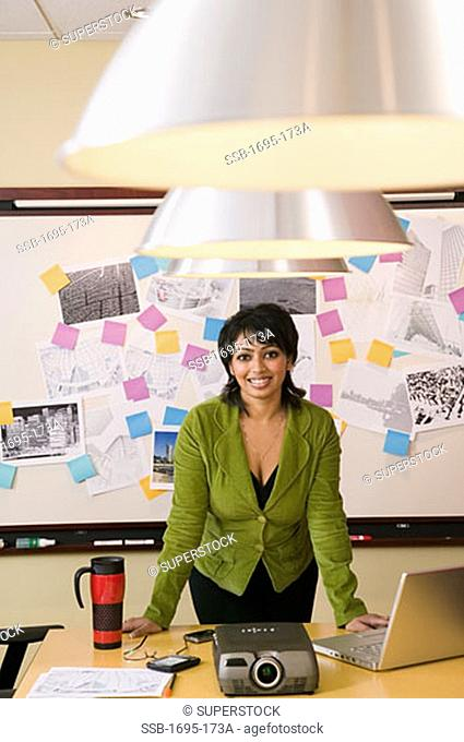 Front view of a businesswoman standing in a conference room