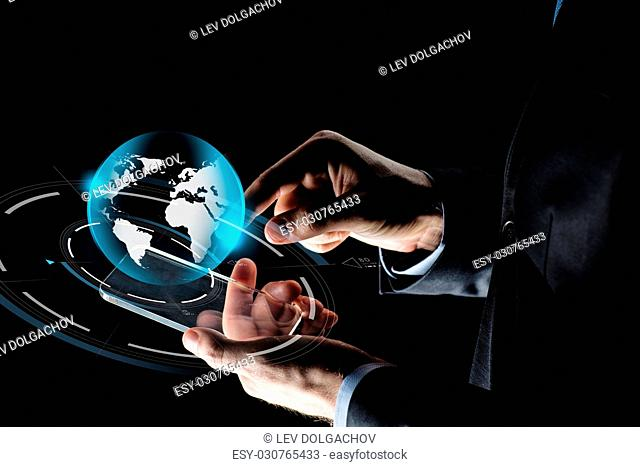 business, mass media, people and future technology concept - close up of businessman hands with transparent smartphone and virtual earth hologram over black...